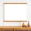 Poster hanger mockup over a wooden sideboard table