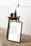 Picture frame mockup by a wooden stool