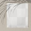 Blank paper with palm leaves shadow on a concrete wall