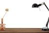 Black desk lamp on a wooden table design element