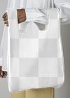 Black woman carrying a white reusable grocery bag mockup
