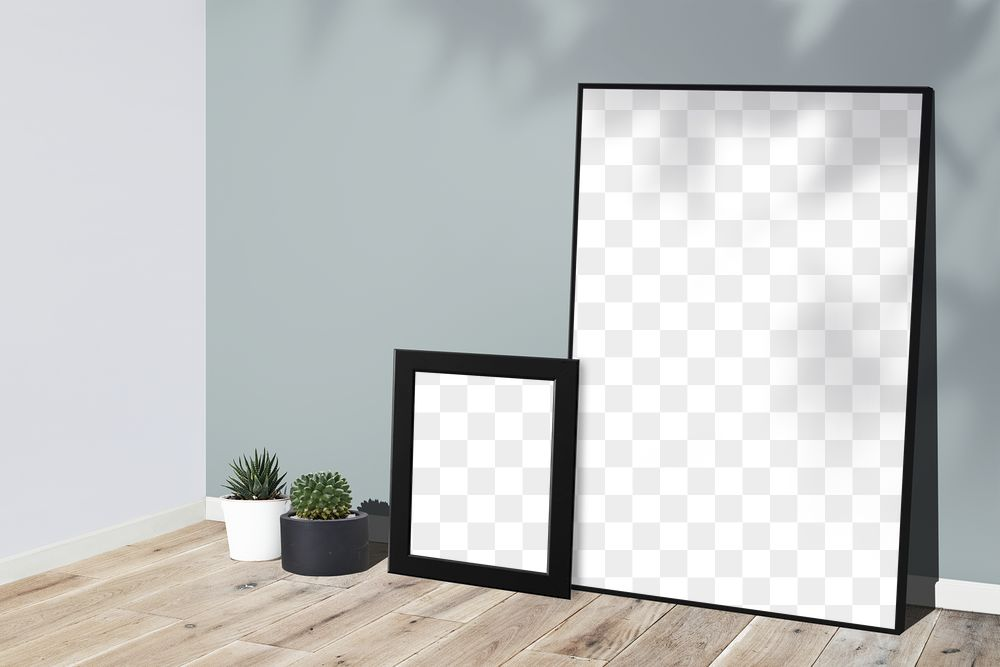Picture frame mockups leaning against a gray wall on a wooden floor