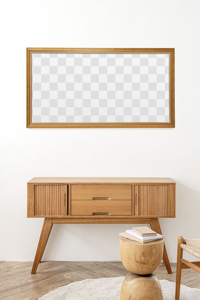 Picture frame mockup above a wooden sideboard table