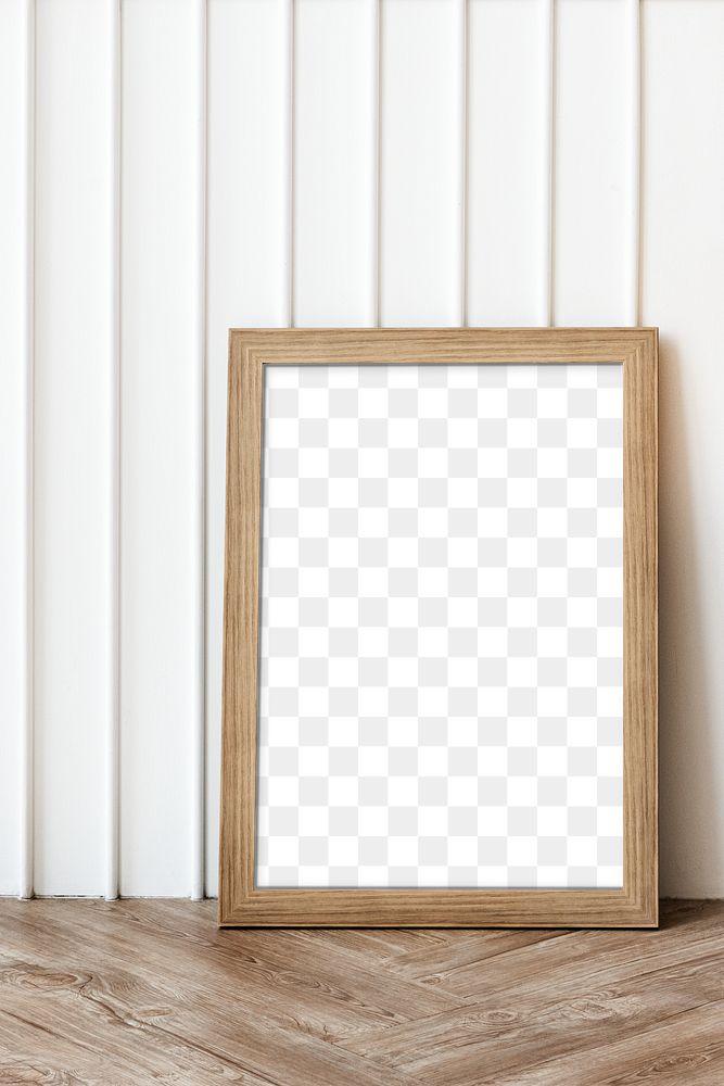 Wooden frame on a parquet floor design element