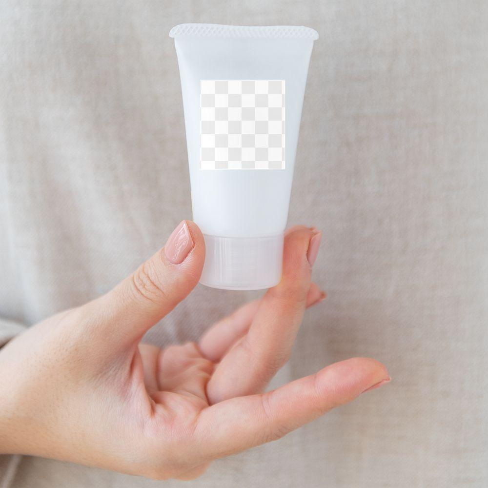 Woman holding a facial cream tube design element